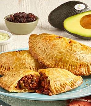 Avocado Picadillo Hand Pies with Double Garlic Avocado Aioli