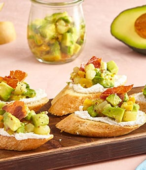 Crostini with Whipped Goat Cheese, Pear Chutney Guacamole, and Crispy Prosciutto