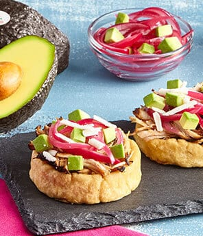 Orange Pulled Pork Mini Sopes with Pickled Avo and Onion