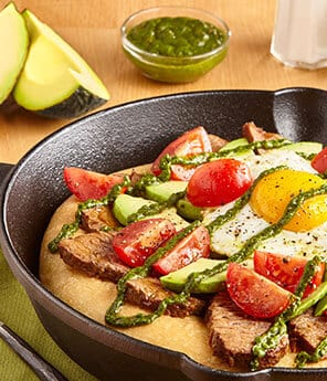Braised Brisket Skillet Breakfast Pizza with Egg, Avocado, and Chimichurri