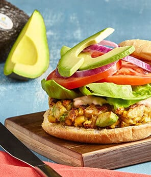 Avocado and Roasted Corn Crab Burgers with Chipotle Crema