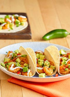 Spicy Shrimp Tacos with Avocado Salsa and Sour Cream Cilantro Sauce